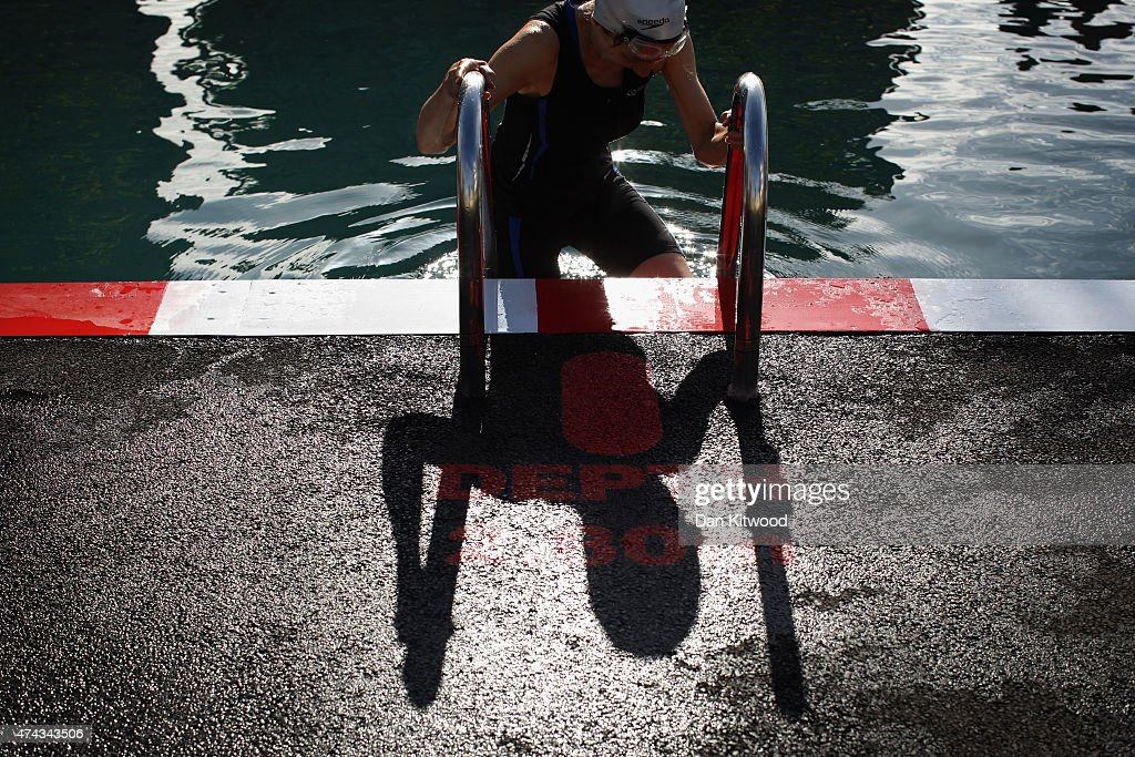 A member of the East German Ladies' swimming team enters the new 'King's Cross Pond Club' outdoor swimming pool on May 22, 2015 in London, England. The 40 metre pool is purified using submerged plants to filter the water and is surrounded by flowers and plants. It is open to members of the public Monday and Friday between 6am and dusk.