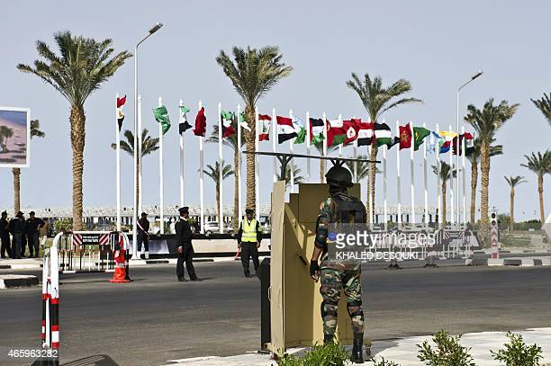 A member of the Egyptian presidential guard stands outside the conference hall in the Red Sea resort of Sharm elSheikh on March 12 on the eve of the...
