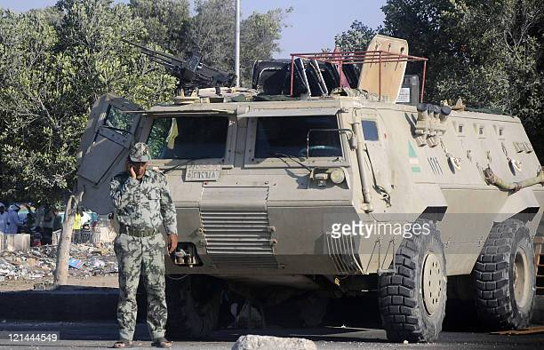 A member of the Egyptian security forces speaks on the phone while securing an area in ElArish on the Sinai peninsula on August 19 2011 An Egyptian...
