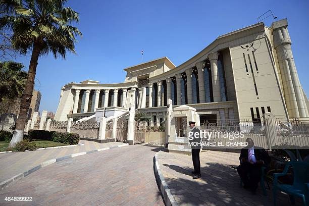 A member of the Egyptian security forces stands guard outside the constitutional court during a session to rule on the law organising the upcoming...