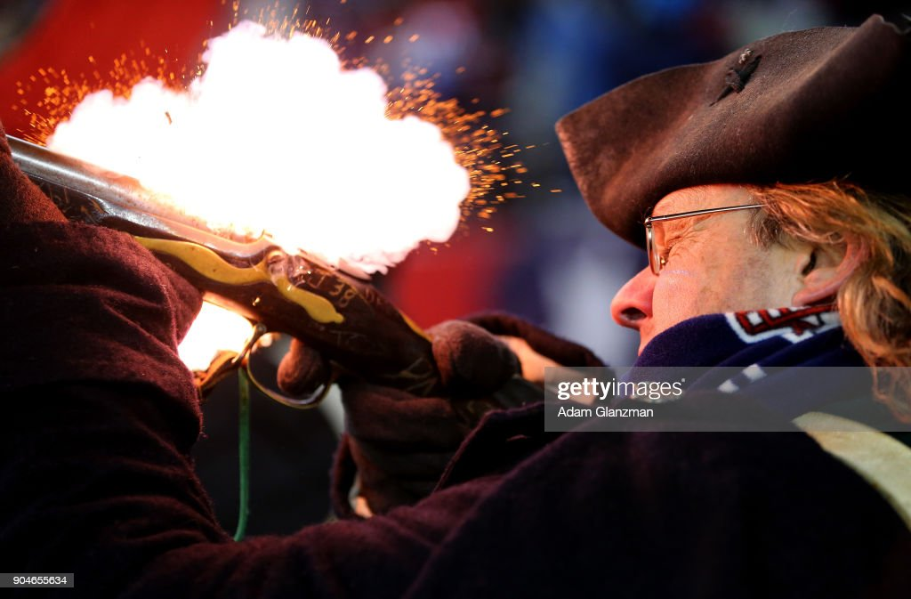 A member of the end zone militia fires a gun after a touchdown in the fourth quarter in the AFC Divisional Playoff game between the New England Patriots and the Tennessee Titans at Gillette Stadium on January 13, 2018 in Foxborough, Massachusetts.