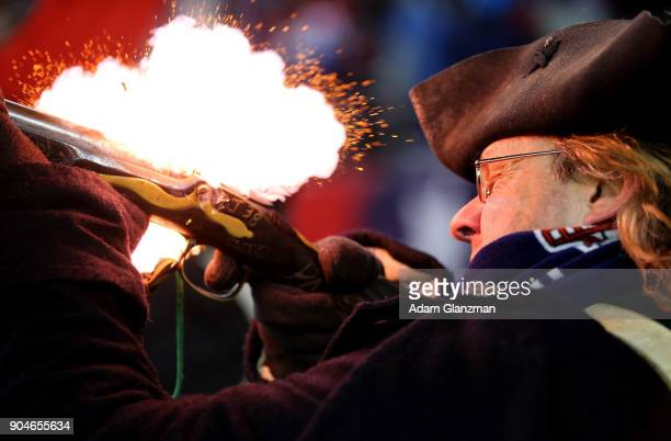 A member of the end zone militia fires a gun after a touchdown in the fourth quarter in the AFC Divisional Playoff game between the New England...