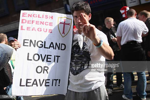 A member of the English Defence League protests near Tower Hamlets on September 3 2011 in London England Members of the EDL held a static protest in...