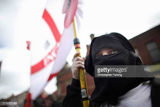 A member of the English Defence League wears a mock burka as the EDL gather for a demonstration against radical Islamism on April 2 2011 in Blackburn...