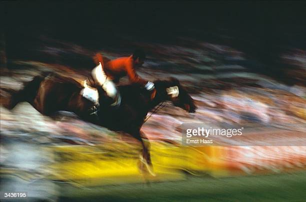 A member of the equestrian team leaps a fence during the 1972 Munich Olympics In Germany book