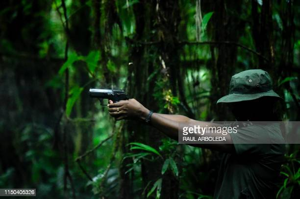 Member of the Ernesto Che Guevara front, belonging to the National Liberation Army guerrillas, shoots during a training in the Choco jungle,...