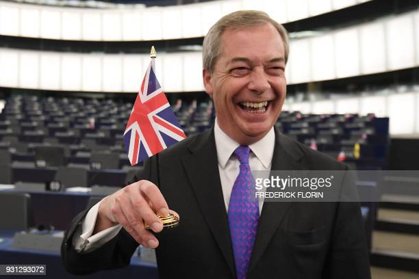 Member of the European Parliament and former leader of the antiEU UK Independence Party Nigel Farage holds a British flag prior a plenary session at...