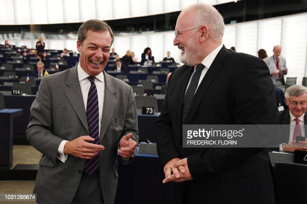 Member of the European Parliament Nigel Farage speaks with European Commission First VicePresident Frans Timmermans prior to a debate concerning...