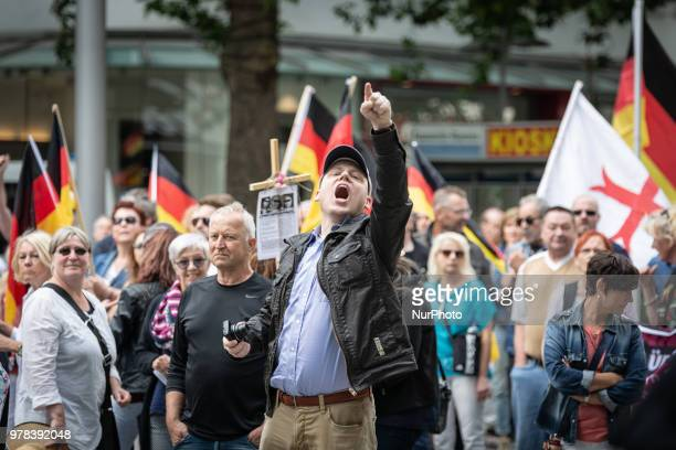 A member of the far right Hagida movement pointing his finger and shouting at counter protestors during the demonstration in Hannover Germany June 17...