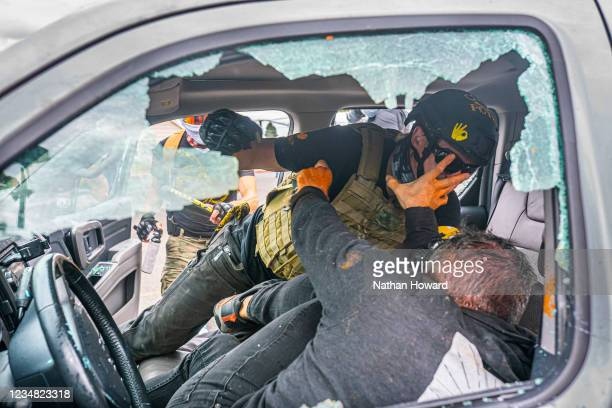 Member of the far-right group Proud Boys and a left-wing counter protester fight in a truck on August 22, 2021 in Portland, Oregon. The Proud Boys...