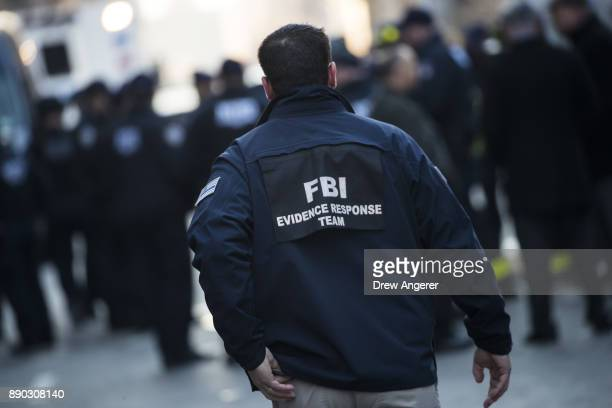 A member of the FBI arrives at the scene near the New York Port Authority Bus Terminal December 11 2017 in New York City The Police Department said...