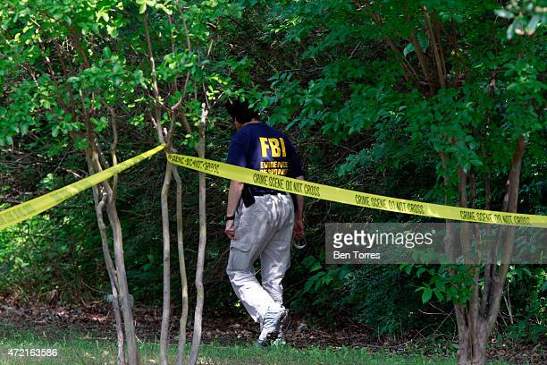 A member of the FBI Evidence Response Team investigate the crime scene outside of the Curtis Culwell Center after a shooting occurred the day before...