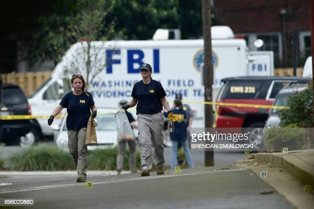 Member of the FBI inspect the crime scene after a shooting during a practice of the Republican congressional baseball at Eugene Simpson Statium Park...