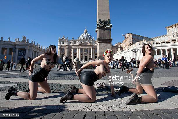 Member of the Femen group stage a protest in Vatican City