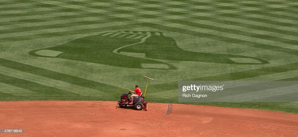 A member of the Fenway Park grounds crew drives a machine