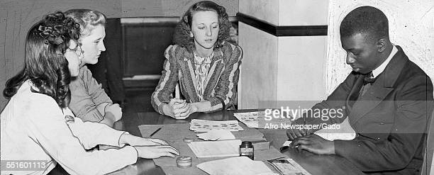 A member of the fingerprint unit at the school meeting in the NYA group cooperating with the FBI fingerprinting people of both races 1946