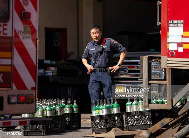 A member of the Fire Department of New Yorks Emergency Medical Team stands next to a resupply of oxygen tanks used in ambulances at the Elmhurst...