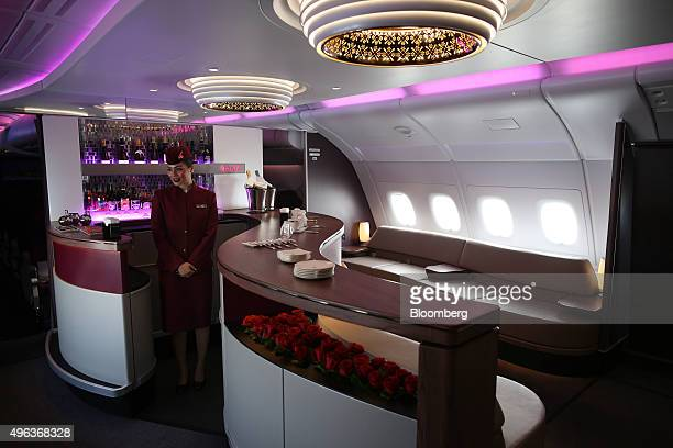 A member of the flight crew stands at the bar for business class passengers aboard an Airbus A380800 aircraft operated by Qatar Airways Ltd on the...