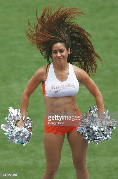 A member of the Florida Marlins Mermaids cheers during the game against the San Diego Padres at Dolphin Stadium on May 6 2007 in Miami Florida The...