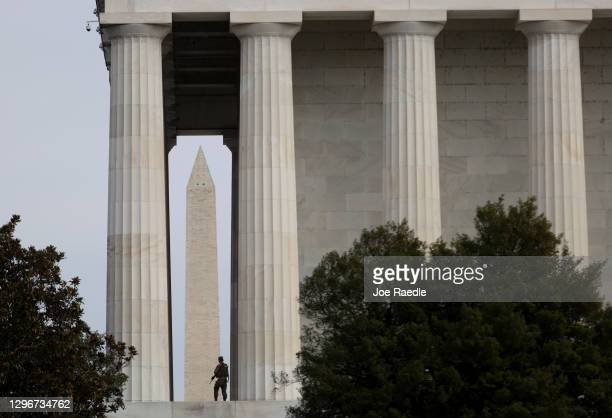 Member of the Florida National Guard stands guard at the Lincoln Memorial on January 16, 2021 in Washington, DC. After last week's riots at the U.S....
