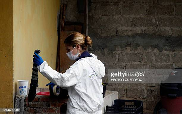 A member of the forensic service holds a bowie knife at the crime scene where five people were killed in San Juan de Ocotan Jalisco state Mexico on...