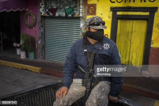 Member of the Forest Keepers sits in a vehicle while on patrol in search of ilegal loggers in Cheran, Michoacan State, Mexico, on Friday, June 9,...