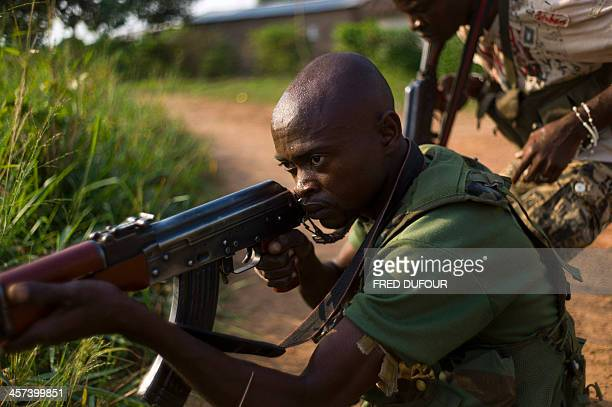 A member of the former Central African Armed Forces and antibalaka militian takes part in a drill in the suburbs of Bangui on December 17 2013...