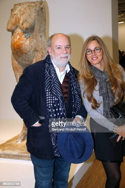 Member of the French Academy Marc Lambron and Delphine Marang Alexandre attend the Cesar Retrospective at Centre Pompidou on December 11 2017 in...