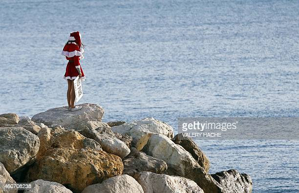 A member of the French antifur group 'CAFT' dressed up as Santa Claus looks at the sea during a demonstration on December 20 in Nice southeastern...