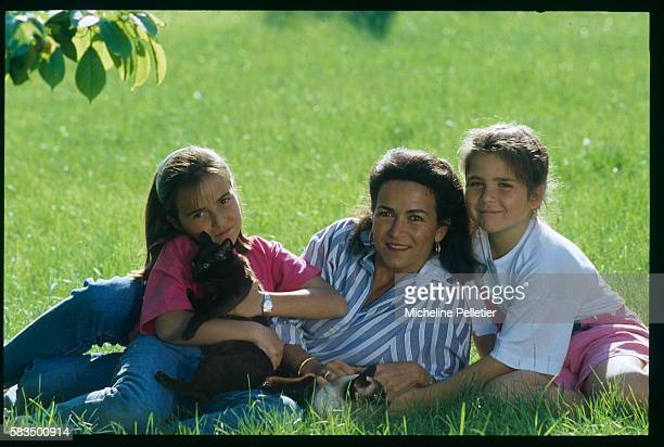 Member of the French rightwing political party Rassemblement Pour la Republique Michele Barzach enjoys some family time with her two daughters...