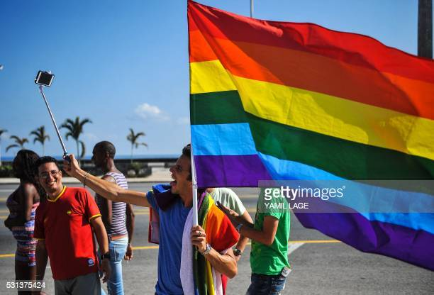 A member of the gay and lesbian community makes as selfie during a march against homophobia on May 14 2016 in Havana / AFP / YAMIL LAGE