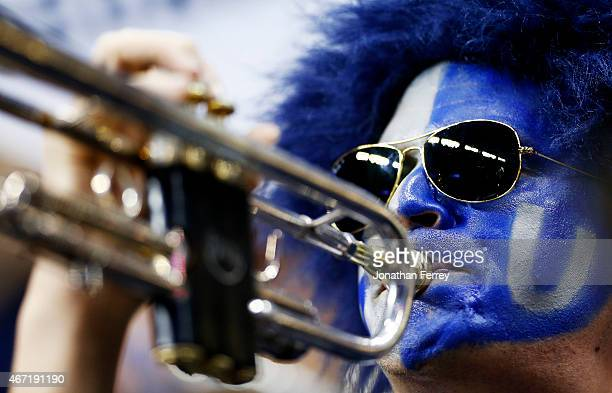 A member of the Georgetown Hoyas band performs in the second half against the Utah Utes during the third round of the 2015 NCAA Men's Basketball...