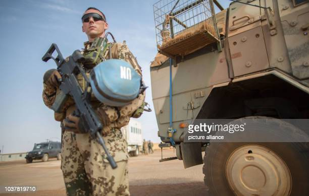 Member of the German armed forces watches the arrival of German defence minister Ursula von der Leyen in Gao, Mali, 05 April 2016. German defence...