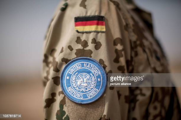 Member of the German armed forces wears a a uniform that features a logo of the United Nations at Camp Castor in Gao, Mali, 05 April 2016. Members of...