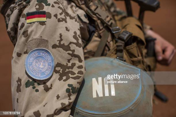 Member of the German armed forces wears a helmet that features a logo of the United Nations at Camp Castor in Gao, Mali, 05 April 2016. Members of...