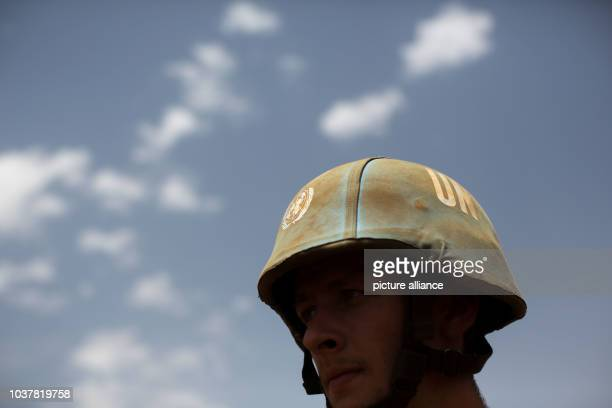 Member of the German armed forces wears a helmet that features a logo of the United Nations during a drill at Camp Castor in Gao, Mali, 05 April...