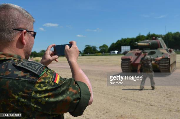 A member of the German Army seen in Normandy Victory Museum in La Fourchette near Carentan takes a picture of Panther V German tank in action just a...