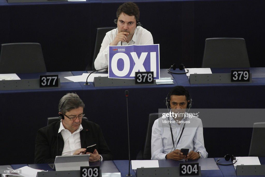Member of the German left wing party Die Linke Fabio De Masi holds a placard with the Greek word OXI, referring to the recent Greek Referendum result in the Plenary room of the European Parliament on July 7, 2015 in Strasbourg, France. President of the EU Parliament Martin Schulz has said that the consequences of the Greek referendum result, which rejected the European Bailout deal with great majority, has increased the risks of national bankruptcy in Greece.