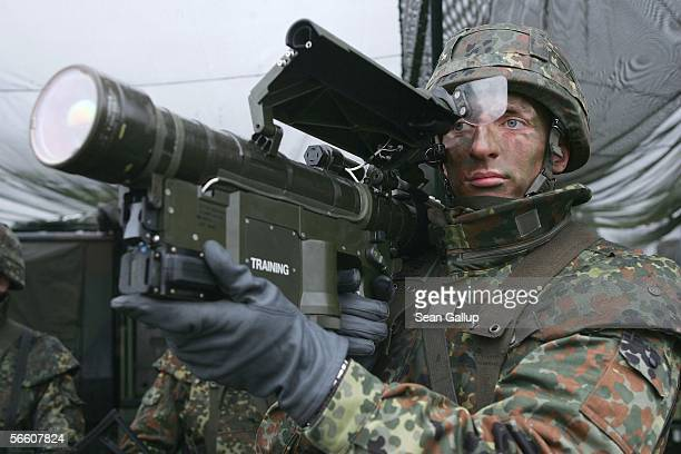 A member of the German Lutfwaffe holds a Stinger antiaircraft missile launcher in a capabilities demonstration during the visit of German Defense...
