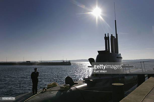 A member of the German Navy aboard the new U32 watches the inauguration ceremony for the U31 and its sister boat the U32 on October 19 2005 in...