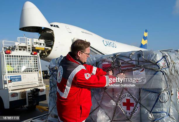 A member of the German Red Cross checks a shipment of aid destined for the Philippines at Schoenefeld Airport before the aid was loaded on to a...