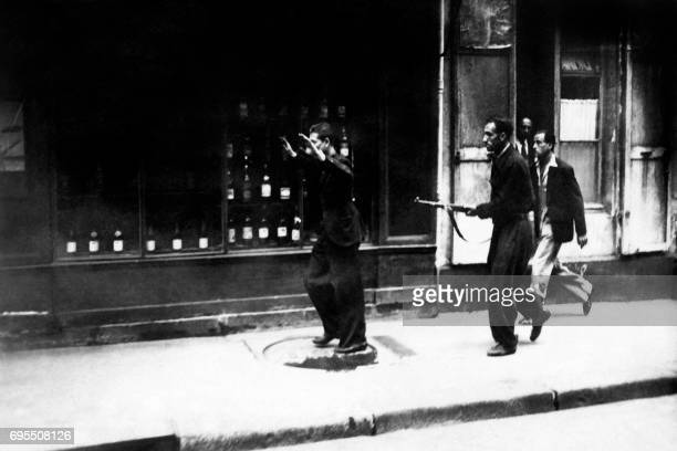 A member of the Gestapo is by FFI fighters arrested in the Nollet street in Paris in August 1944 during the battle for the Liberation of Paris during...