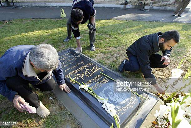 Member of the 'global committee for the martyrs of Islam' add the finishing touches to a newly laid tombstone to honour Khaled Eslamboli the assassin...