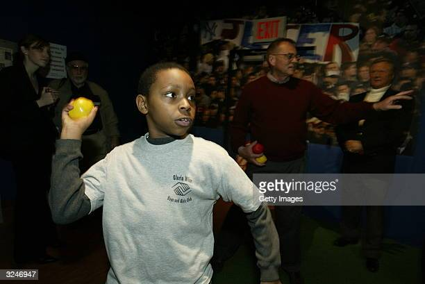 A member of the Gloria Wise Boys And Girls Club throws a pitch at the launch of a new interactive experience featuring a figure of baseball player...