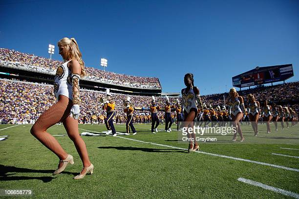 A member of the 'Golden Girls' dance team performs before the game between the Louisiana State University Tigers and the Alabama Crimson Tide at...