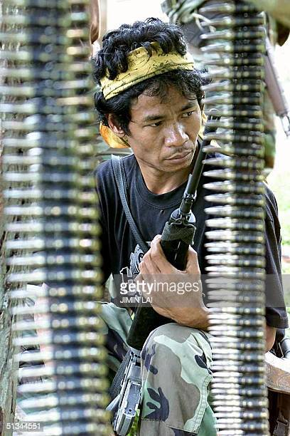 A member of the government militia working with the joint police and Autonomous Region in Muslim Mindanao force patrols the area leading to the Abu...
