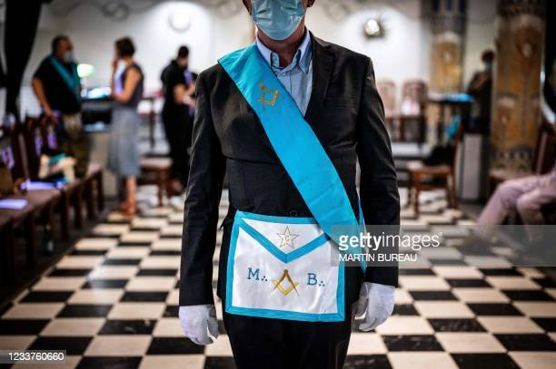 Member of the Grande Loge Mixte de France poses with masonic apparel, in Paris, on June 18, 2021. - With a suspended or reduced activity, Freemasonry...