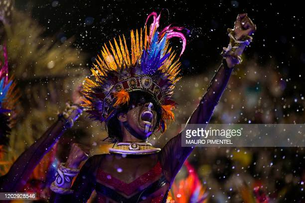 A member of the Grande Rio samba school performs during the first night of Rio's carnival parade at the Sambadrome in Rio de Janeiro Brazil on...