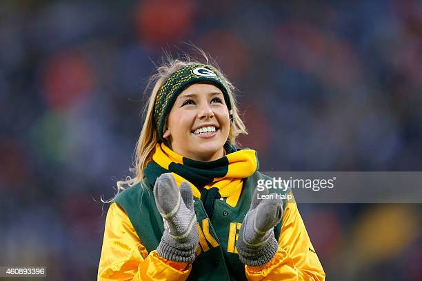 Member of the Green Bay Packers Green cheerleaders squard entertain the fans during the third quarter of the game against the Detroit Lions at...