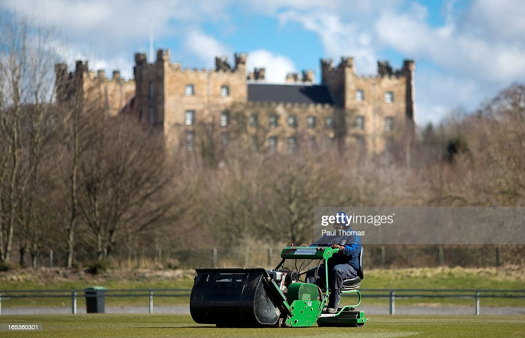 A member of the ground staff cut the grass during a Durham CCC pre-season photocall at The Riverside on April 3, 2013 in Chester-le-Street, England.